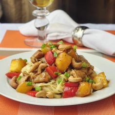 Spicy Mango Orange Pork with Cashews - this dish comes together so quickly that your family could be sitting down to dinner in less time than it takes for a take-out delivery...and it's likely to be a whole lot tastier too.