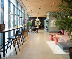 Ordinary reception and lobby areas are designed to blend into different ambiances, components that look like essential to a hotel, such as a reception counter are designed as shared tables.