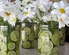 lemon and flowers in glass canning