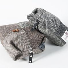 UPCYCLED VINTAGE JACKET TOILETRY BAGS Our stylish and practical toilet bag is now available in tweeds recycled from vintage Harris Tweed jackets. Each one is entirely unique and has original jacket buttons as a motif on the tweed. Strong nickel zip closure with black leather puller. Strong red waterproof lining. Handmade in Scotland
