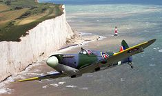 Stunning picture of a Spitfire flying over the White Cliffs of Dover.