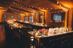 barn-wedding-string-lights-rustic-chic-farm-tables-uplighting-amber