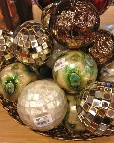 Peacock Feather, Gold and Silver Mosaic and Mosaic Capiz Shell Decorative Spheres from Pier Loving the peacock feather orbs.