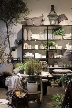 Visual Merchandising. Retail store display. Home decor and accessories. Whites with green and grays. VM.