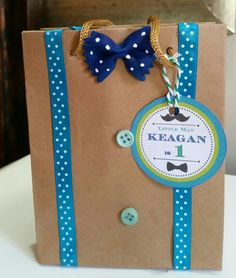 Little Man Party favor bag#brownpaperbag#ribbons and buttons#bowtie pasta painted
