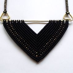 Geometric Macrame Necklace!  Its name : Abrazo Cerrado in spanish, V- shape or Close embrace in English! Its about the most beautiful dance embrace in tango. The dancers chests are closer to each other than their hips forming in that way a ... Triangle with the floor! Guess why I gave this name to my necklace ;)  DIMENSIONS Main part : 9 x 6 cm Adjustable Length : Maximum : 41.5 cm (approx)  It will be made to order just for you, at the color of your choice! (In the last picture youll find…