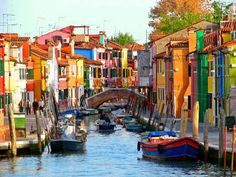 Burano Island, in Venice, Veneto, Italy. Burano Island is famous for its colorful houses, fish and lace making. Legend goes that the people of Burano started making lace after getting jealous of a fisherman's bride, who had a crown of sea foam. It was given to her by the fisherman, who had gotten it from the Queen of the Waves as a reward for resisting a song of mermaids while waiting for his beloved to return.