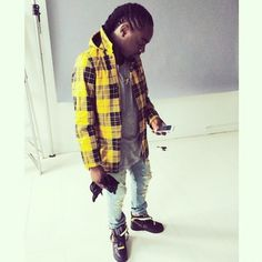 Wale recently shared a photo of himself on Instagram wearing a Supreme Dry Barn Yellow Plaid Coat ($288). Description from myhellofalife.com. I searched for this on bing.com/images
