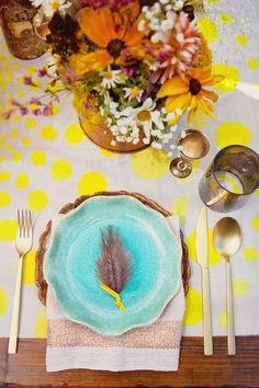 Bohemian chic place setting with turquoise plates + painted yellow dotted runner. Designed by EnjoyEventsCo.com and shot by TinywaterwaterPhotography.com