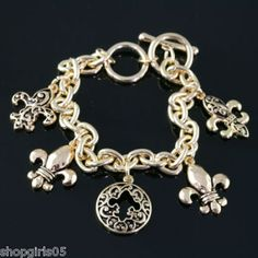 NEW!  FLEUR DE LIS GOLD COLOR BRACELET.  REALLY PRETTY!!!!