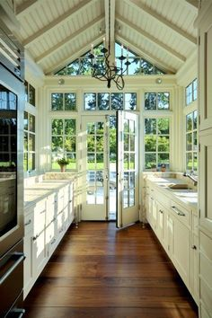 Dream Kitchen. White, vaulted peaked ceiling, chandelier, stainless steel appliances, french doors, huge windows.
