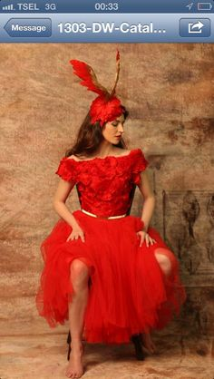 Red Wing Headpieces, dress by Denny Wirawan