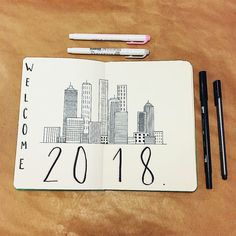 Bullet journal yearly cover page, city skyline drawing. | @studiesofm