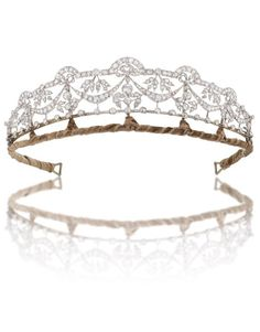 a 1912 diamond floral tiara by Philips. Featuring six diamond garlands hung from fan motifs with additional diamond floral motifs between
