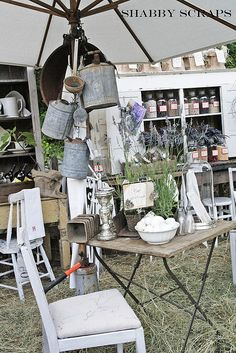 Love the umbrella for displaying galvanized wares and the table for herbs and plants.