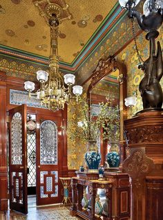 The foyer is entered via antique double doors that feature textured-glass panels and cabochon jewels. Colors of the original encaustic t...