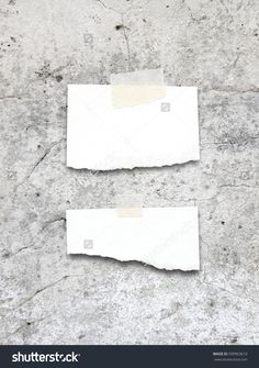 Close-up of two blank ripped pieces of paper frames with adhesive tape on grey concrete wall background