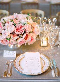 Table setting with light pink flowers