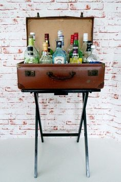 Secure an old suitcase to a TV table for a small but stylish bar. | 33 Gorgeous DIY Projects To Decorate Your Grown Up Apartment