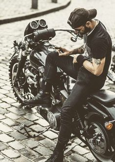 Beard...check, tattoos...check, motor bike...check check...mmm