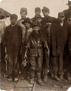 """Shorpy Higginbotham and His Friends - December 1910. Shorpy was a 'greaser' on the tipple at Bessie Mine, of the Sloss-Sheffield Steel and Iron Co. in Alabama. Said he was 14 years old, but it is doubtful. Carries two heavy pails of grease, and is often in danger of being run over by the coal cars."""""""