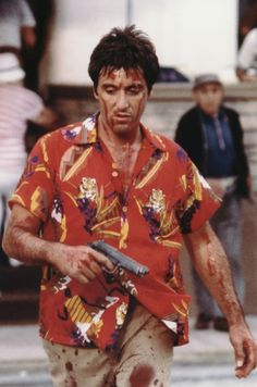 Al Pacino aka Scarface (1983) a determined Cuban immigrant takes over a drug cartel while succumbing to greed. And does it all looking very cool in his Aloha shirts. www.HawaiianShirtDude.com