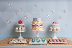 PRINCESS MERMAID BIRTHDAY PARTY THEME IDEA | festive mermaid dessert table with cupcakes, cake, and cookies | Original partyware from Papereskimo.com