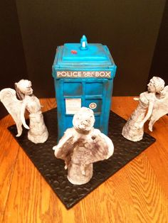 his cake is the TARDIS and Weeping Angels from Doctor Who