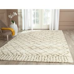 Shop for Safavieh Hand-Tufted Casablanca Ivory/ Green New Zealand Wool Rug (6' x 9'). Get free shipping at Overstock.com - Your Online Home Decor Outlet Store! Get 5% in rewards with Club O! - 16794584