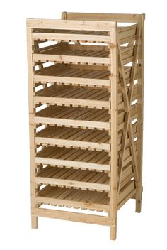 """An Orchard Rack is the Time-Tested Way to Store Your Harvest. Years ago, people stored """"keeper"""" crops such as apples, winter squash, onions and potatoes on rustic wooden racks like this one. The drawers are slatted to ensure good air circulation, and they slide out for easy access."""