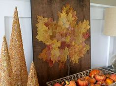 On a stained, neatly trimmed slab of wood, trace out a giant leaf pattern, and glue overlapping fall... - Just a Girl