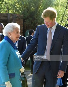 Queen Elizabeth II and Prince Harry attend at the annual Chelsea Flower show at Royal Hospital Chelsea on May 18, 2015 in London, England.