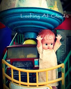 Boo doll in a cart of old shabby vintage toys kitschy cheerful colorful 8 x 10 fine art photograph. Shop: LookingAtClouds