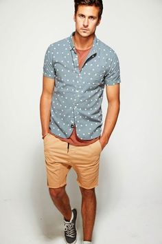 Shop this look on Lookastic:  http://lookastic.com/men/looks/grey-short-sleeve-shirt-tobacco-crew-neck-t-shirt-tan-shorts-charcoal-high-top-sneakers/10415  — Grey Polka Dot Short Sleeve Shirt  — Tobacco Crew-neck T-shirt  — Tan Shorts  — Charcoal High Top Sneakers
