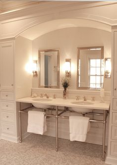Luxurious Master Bathroom. A custom built console sink with polished nickel legs and French limestone slab counter. Custom floor to ceiling cabinetry with arch. Medicine cabinets and lights from Restoration Hardware. White onyx mosaic tile floor and subway walls.   CLICK ON PIN AND LEARN HOW TO MAP PINS WITH YOUR ARCHITECTURE BUSINESS