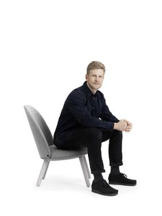 Designer Hans Hornemann with his Ace lounge chair
