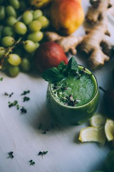 Get the recipe for this healthy winter wonder green juice, made with pear, kale, apple, grape, cucumber, ginger, lemon! No juicer necessary!