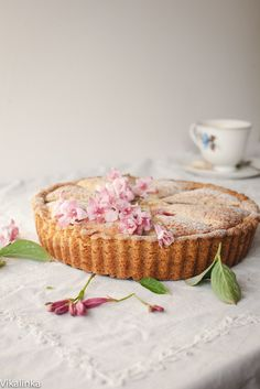 Roasted Rhubarb Bakewell Tart. Buttery tart filled with almond filling and roasted rhubarb. Another take on the British classic.