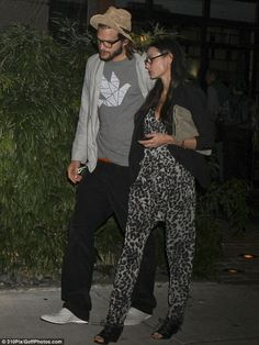 demi moore can wear anything stylishly! i am not a fan of the jump suit but she can pull it off!