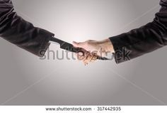 Business Man Shake hands with a business man Knife hand ,Business recreant or business betray  concept, with Clipping Path - stock photo