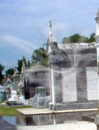 It's not the smoke in this picture but the man on the top side of the tomb , Photo from Randy Leblanc. Spooky Places, Haunted Places, Weird Stories, Ghost Stories, Famous Haunted Houses, Ghost Orbs, New Orleans Cemeteries, Expedition Unknown, Paranormal Pictures