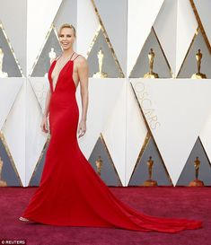 Breaking the rules: It is an unwritten rule that you do not wear red on the red carpet but Charlize Theron proved thinking outside the box has its rewards at the Academy Awards on Sunday in Hollywood