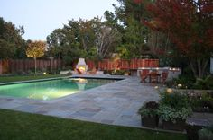 A big backyard can be outfitted with a pool and a relaxing lounge area