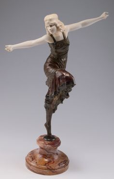 Paul Philippe. Tall 'Russian Dancer', 1920s. H. 50 cm (incl. base). Bronze, dark patina, face, décolletage and arms of carved ivory. Auburn marble base. Plinth marked: Philippe. Base marked: P. Philippe.