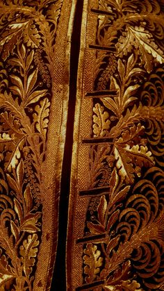 Museum of epoch clothing in Milan / Golden embroidery of a  18 th century jacket