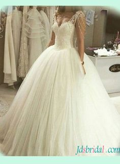 Strappy princess tulle ball gown wedding dress...take the beaded things off the shoulder that drop down on the arm and it's cute