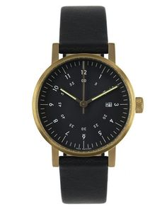 The face of the VOID V03D Black/Gold Watch features concentric numbers, hour and minute hands with a luminescent fill and a discreet branding. Date function. Stainless Steel Case. Quartz Movement. Black Dial. Premium Black Leather Strap. Water Resistant. Swedish Design.