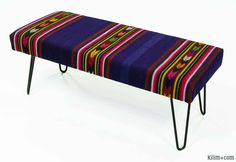 Kilim bench upholstered with vintage Turkish kilim rug. The hairpin legs adds a modern look to the bench.