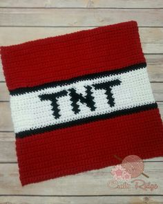 The last square of My Minecraft Obsession is Dynamite…literally. My TNT was done in single crochet with an I hook and Red Heart's cherry red, white and black . Download your PDF here TN…