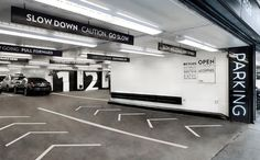 bold black car park navigation working with concrete & white environment